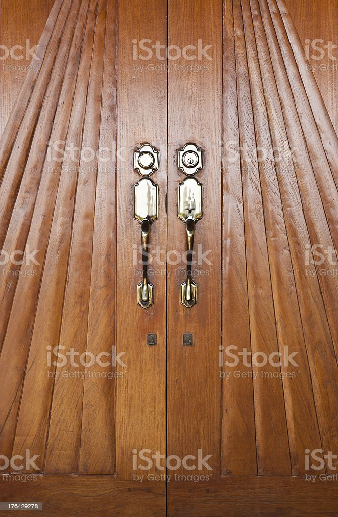 Wooden door with brass doorknob. royalty-free stock photo