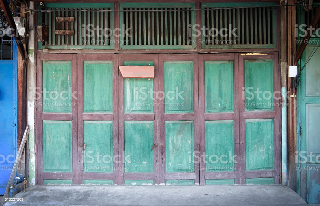 Wooden door with green color stock photo