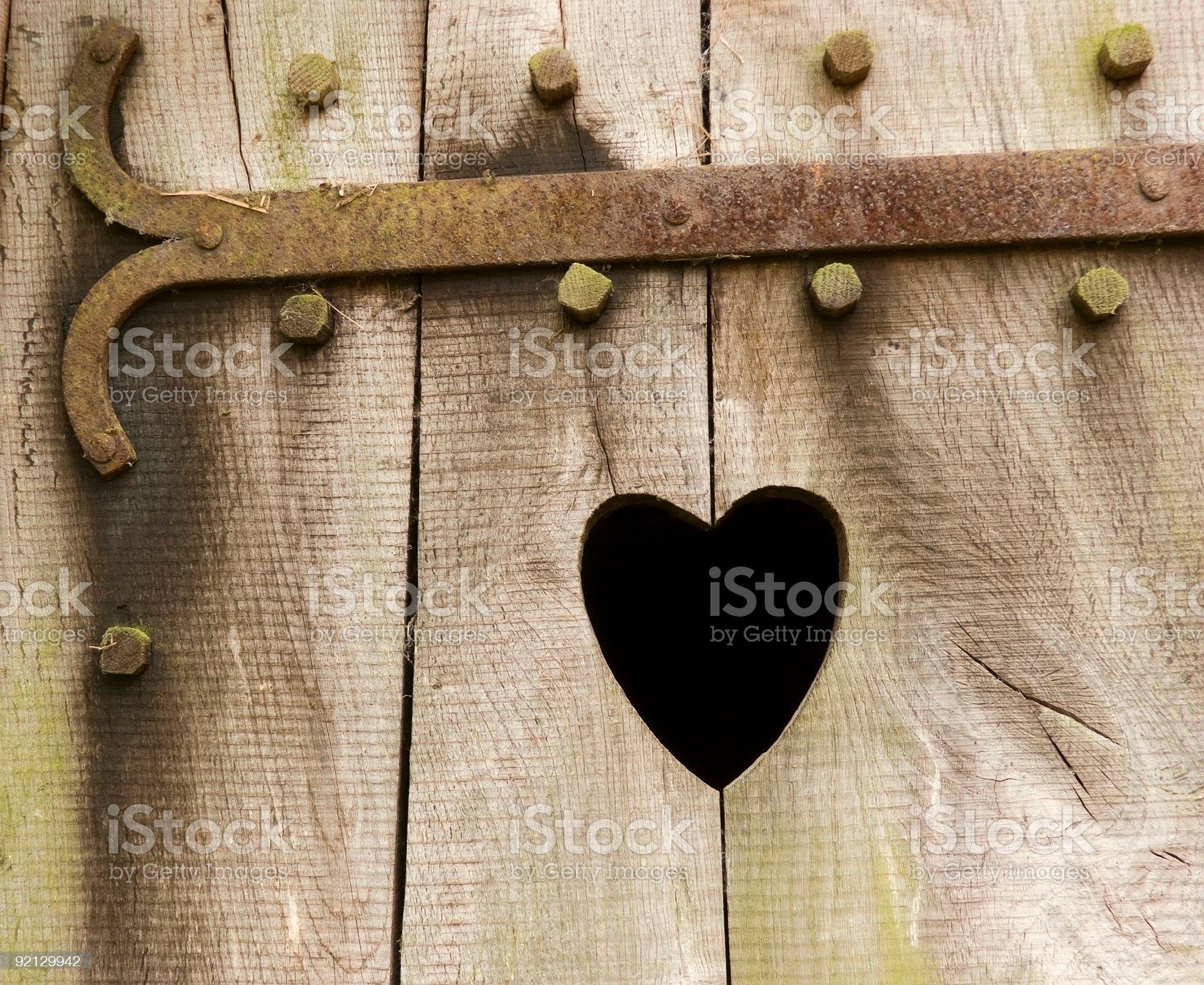 Wooden door with heart royalty-free stock photo