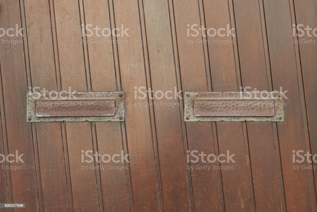 Wooden door with two mail slots stock photo