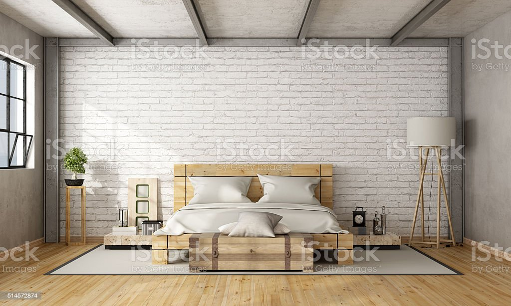 Wooden double bed in loft stock photo
