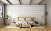 Wooden double bed in loft