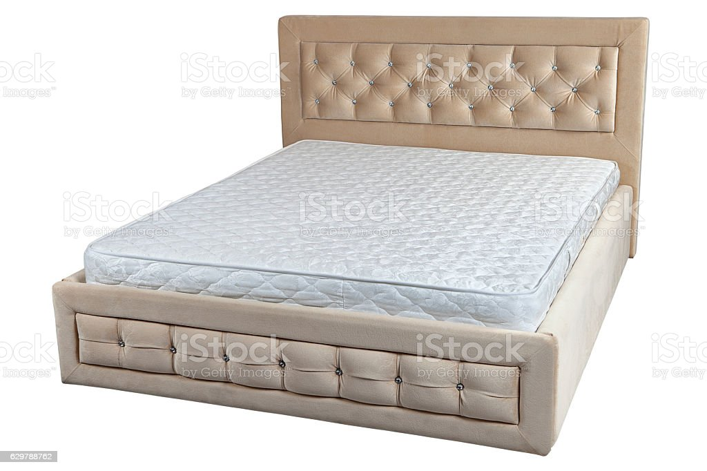 Wooden double bed with cream faux leather, and orthopedic mattre stock photo