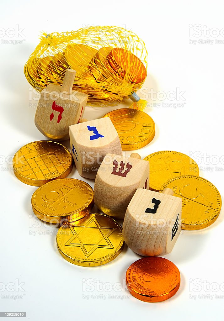 Wooden Dreidels and Gelt royalty-free stock photo