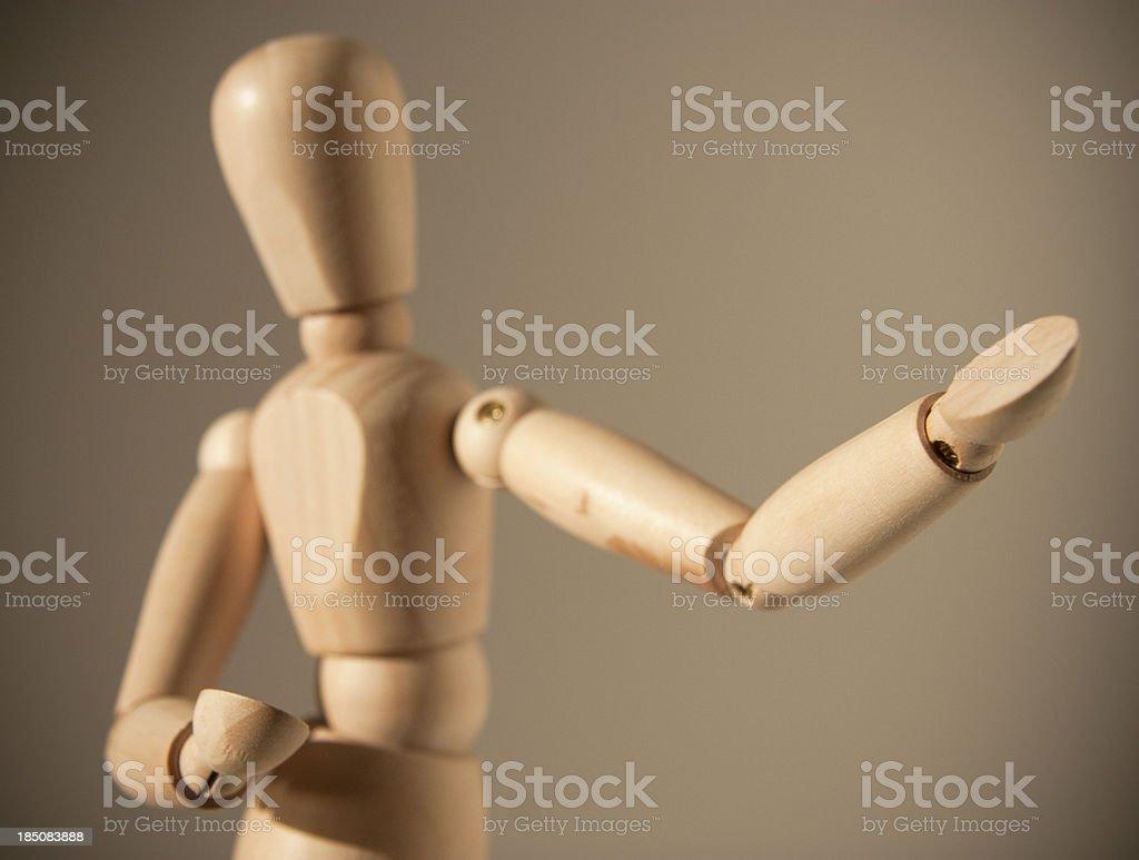 Wooden dummy gesturing stock photo