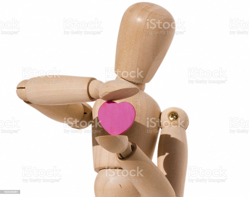 Wooden dummy holding a Heart stock photo