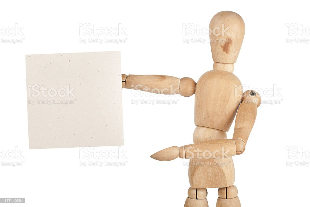 Wooden dummy holding paper stock photo