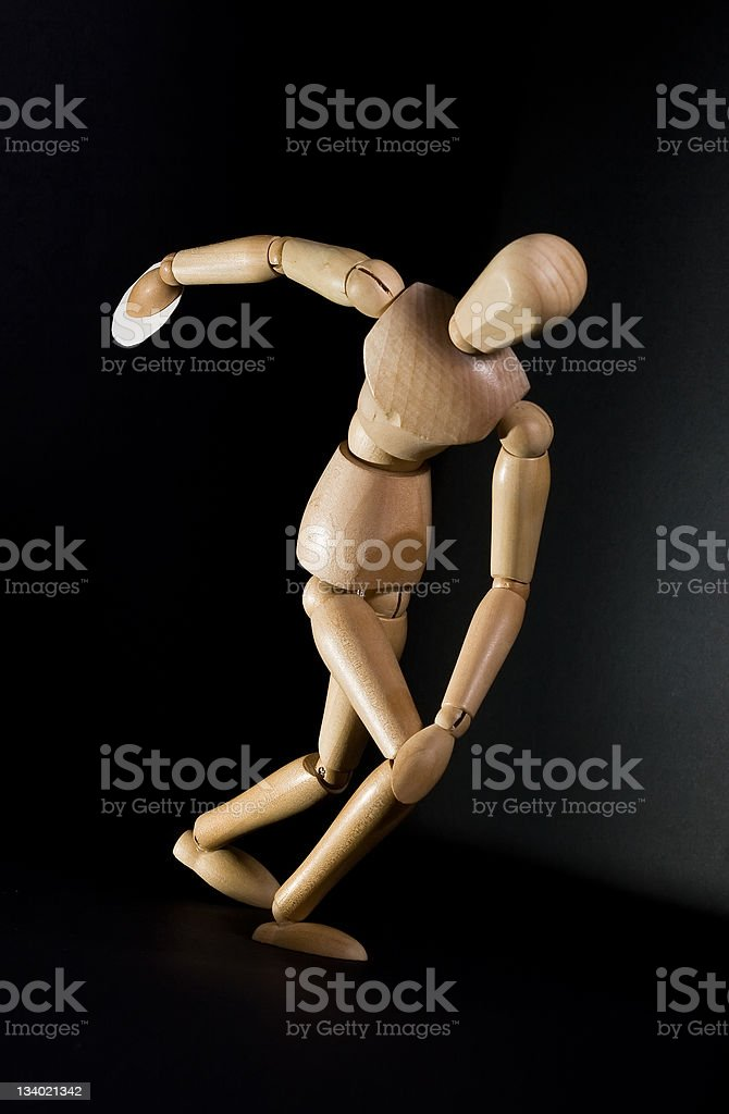 Wooden dummy posing as a discus thrower stock photo