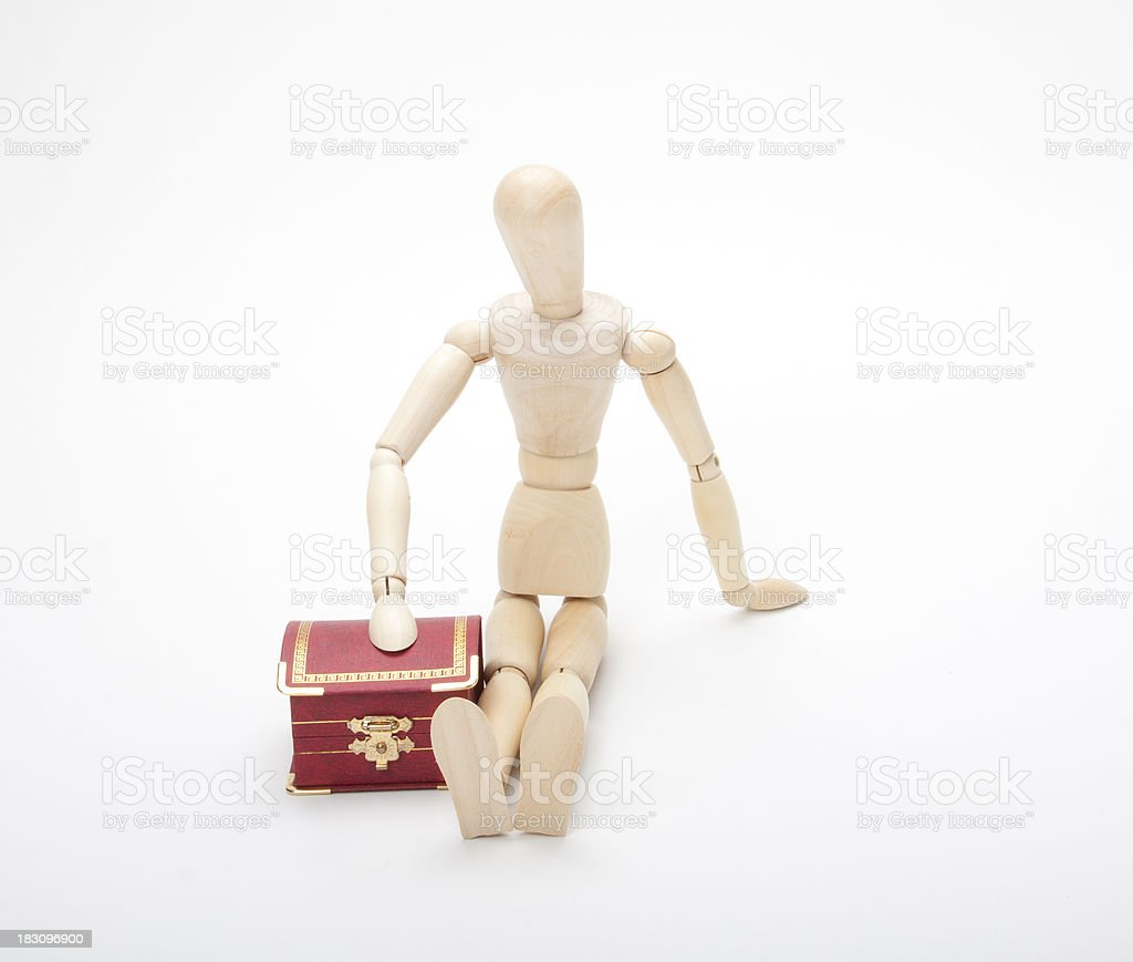 Wooden dummy with gift box, isolated on a white royalty-free stock photo