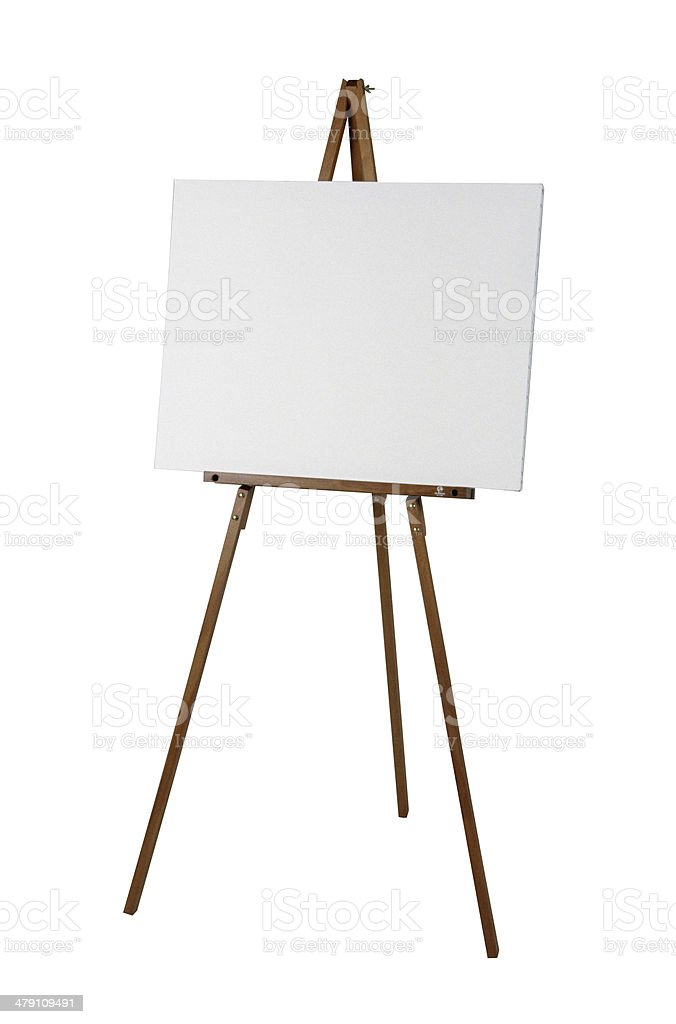 Wooden easel with a white canvas stock photo