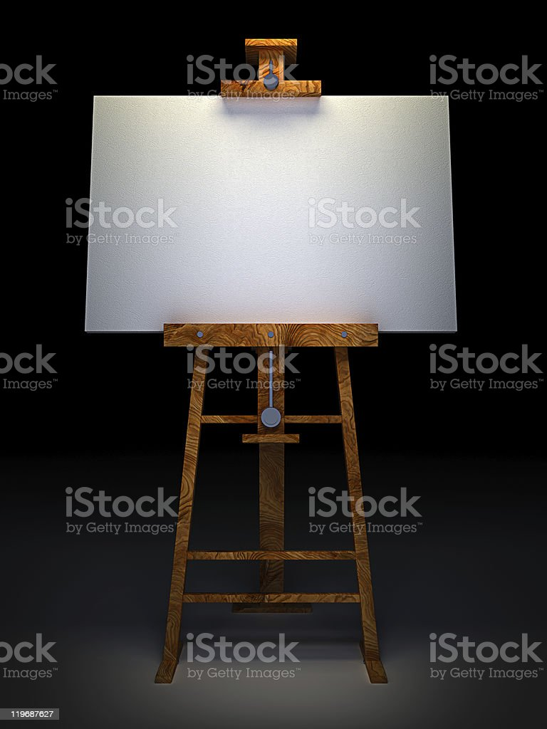 Wooden easel with blank canvas isolated on black stock photo