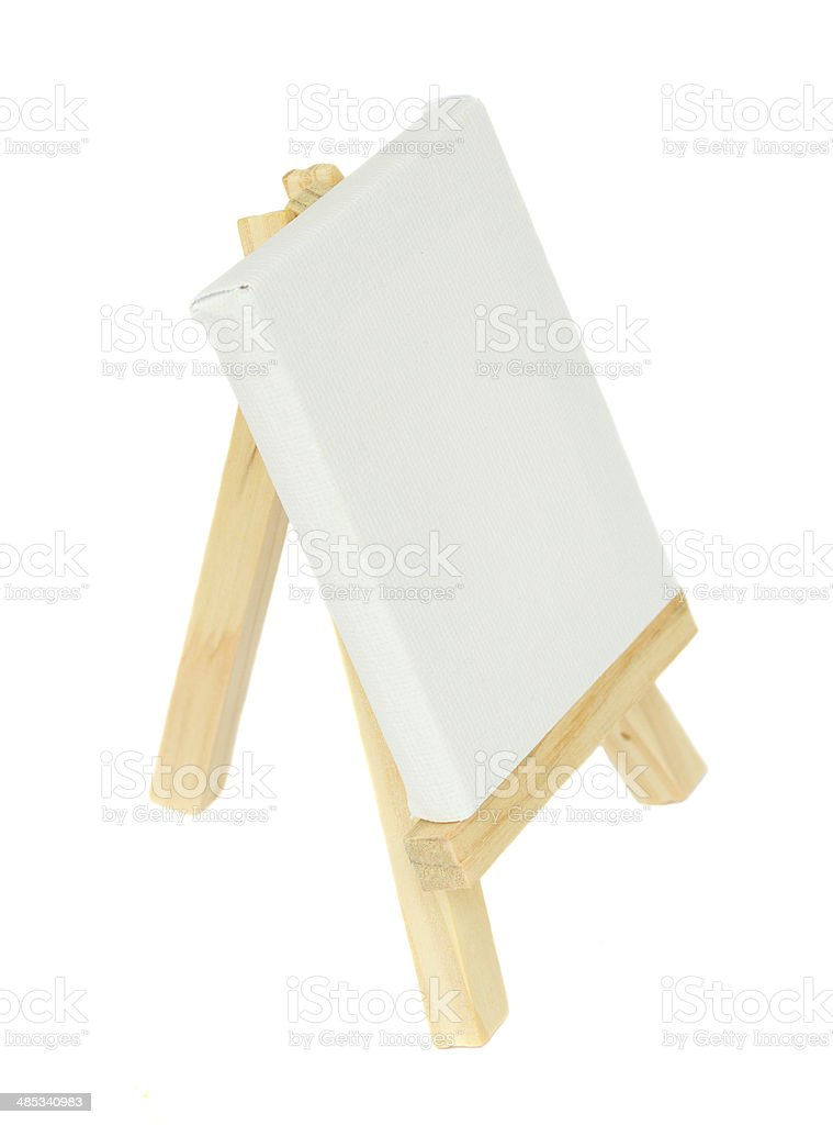 wooden easel with empty canvas stock photo