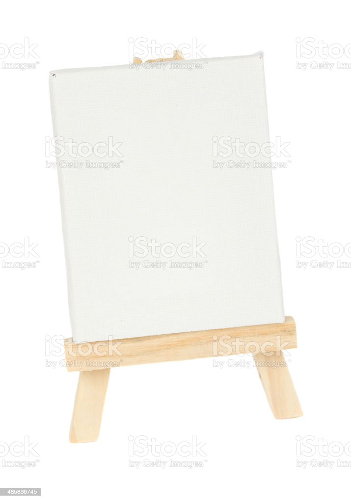 wooden easel with empty white canvas stock photo