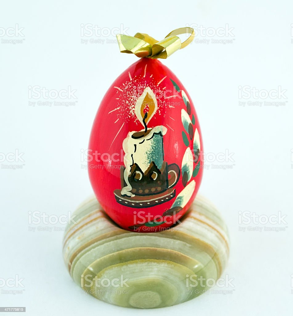 Wooden Easter egg on a stand made of onyx royalty-free stock photo