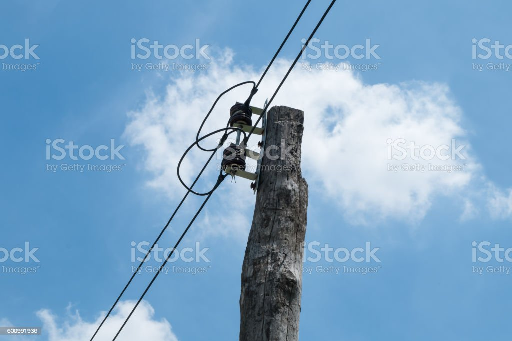 Wooden electric pole stock photo
