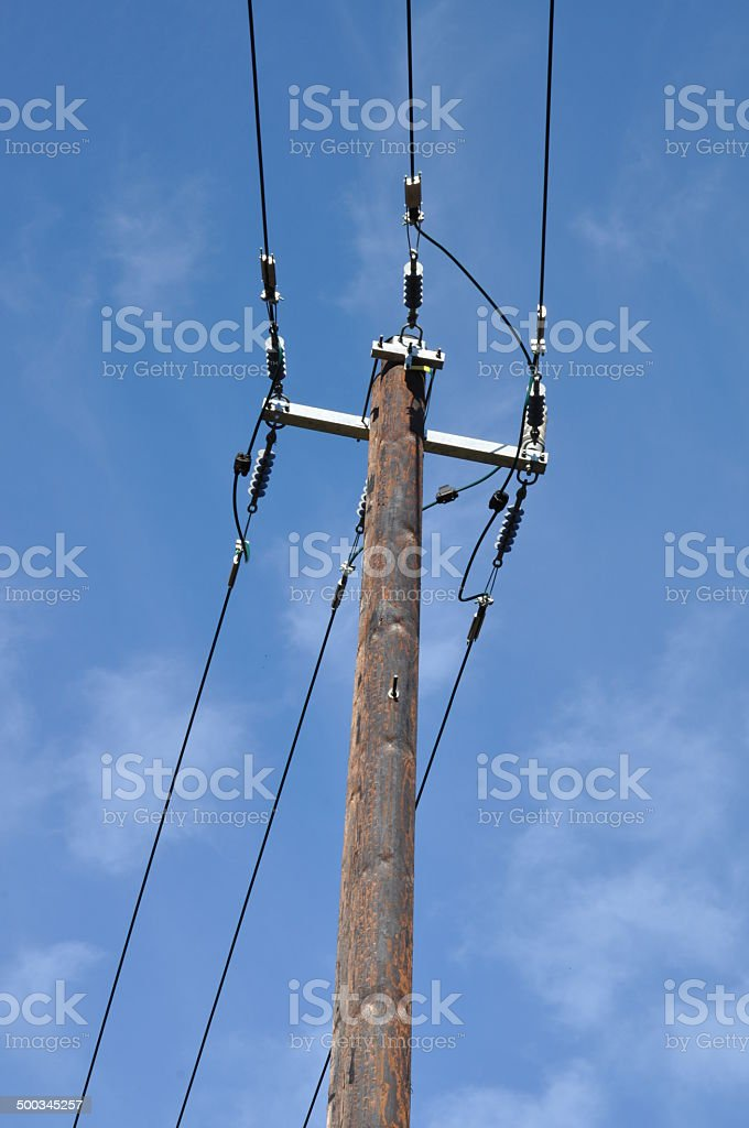 Wooden electric pole with power line royalty-free stock photo