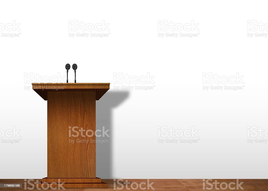A wooden, empty podium with two microphones on stage royalty-free stock photo