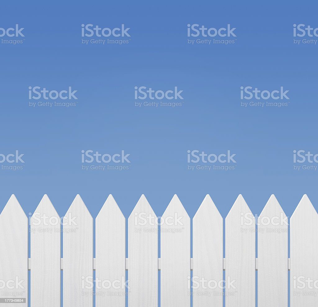 Wooden fence against the clear sky stock photo