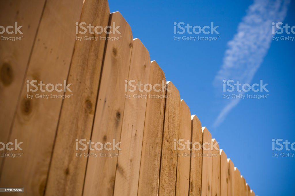 Wooden Fence and Blue Sky stock photo