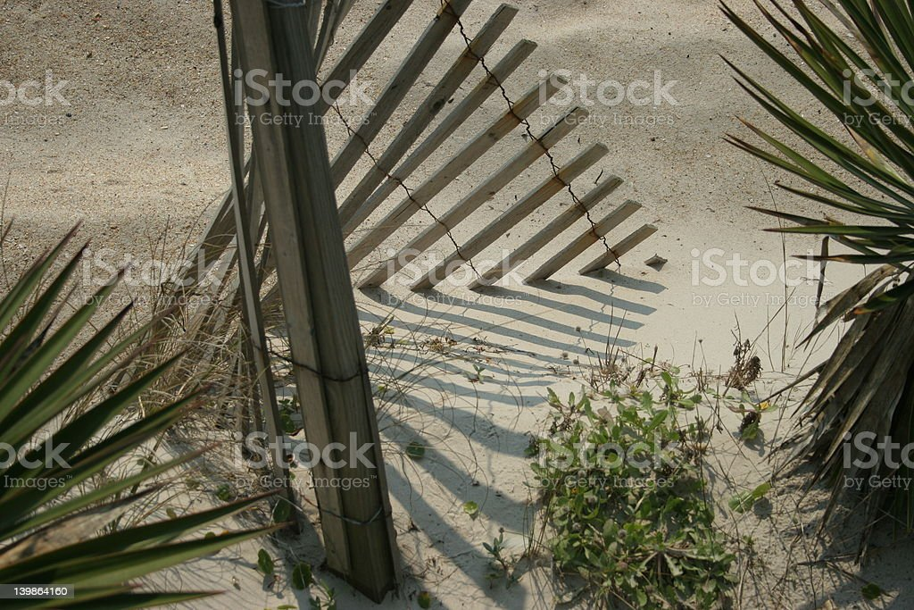 Wooden Fence and Dune royalty-free stock photo