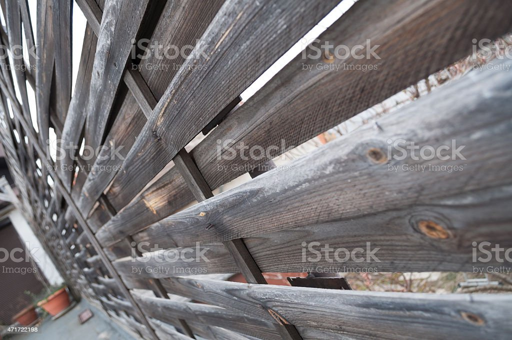 wooden fence and patchworks, interesting viewpoint royalty-free stock photo