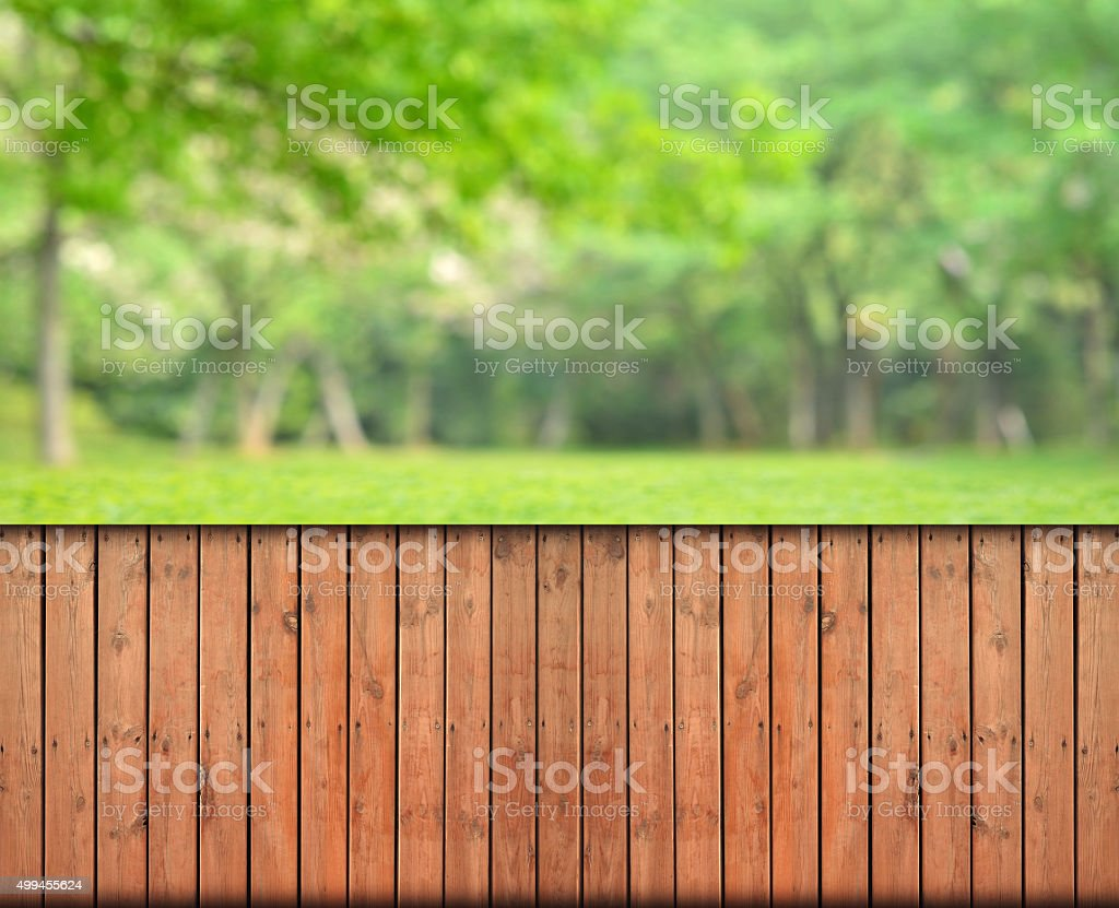 Wooden fence and spring forest defocused abstract background stock photo