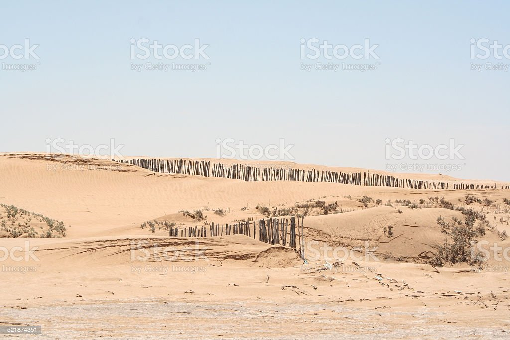 Wooden Fence at Beach, Lagoon of Walvis Bay, Namibia, Africa stock photo