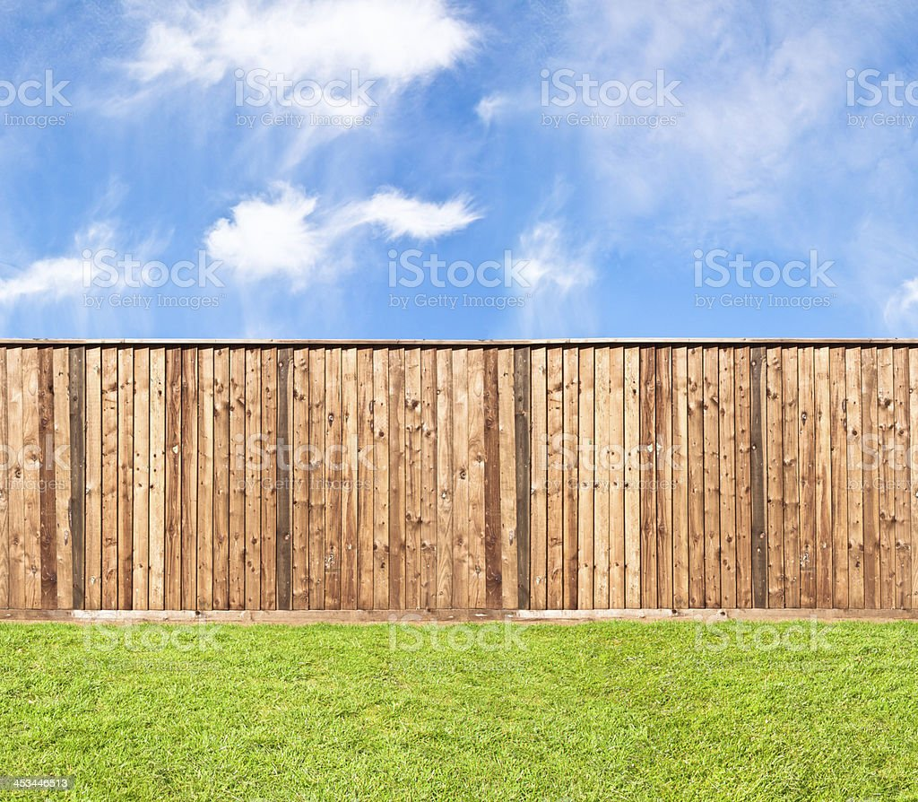 Wooden fence at the grass stock photo