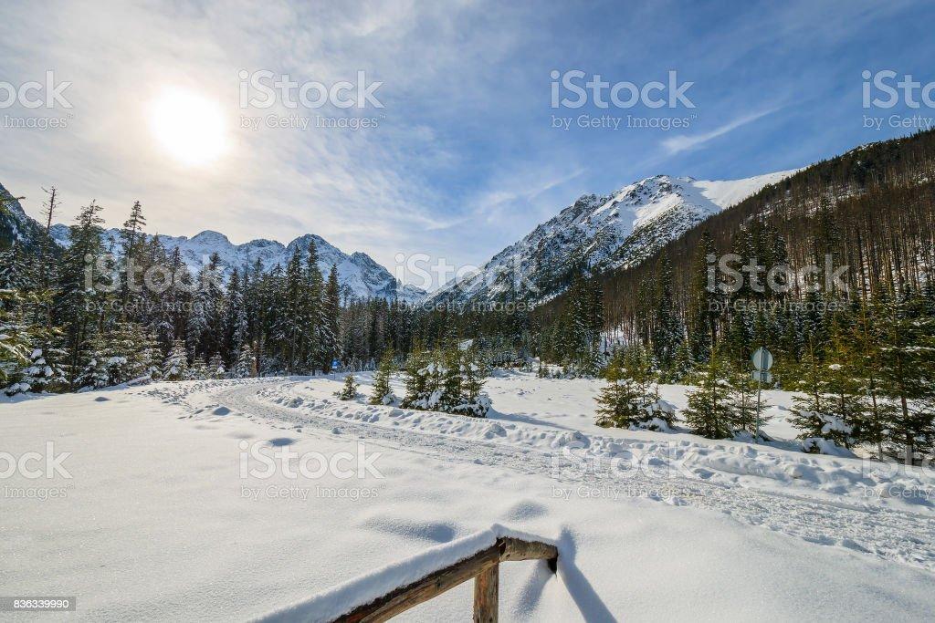 Wooden fence in winter landscape of Tatra Mountains near Morskie Oko lake, Poland stock photo