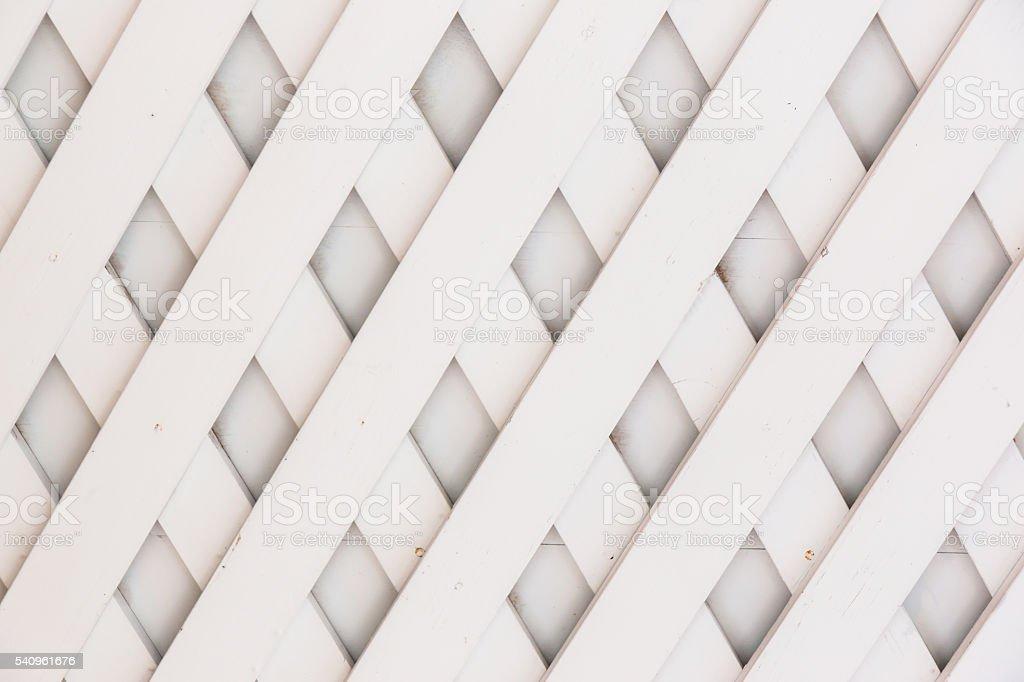 Wooden fence lattice pattern. stock photo