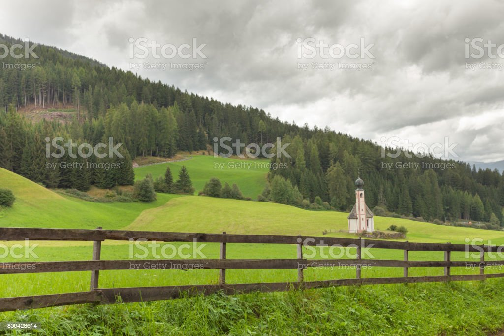 Wooden fence next to  an Italian mountain pasture stock photo