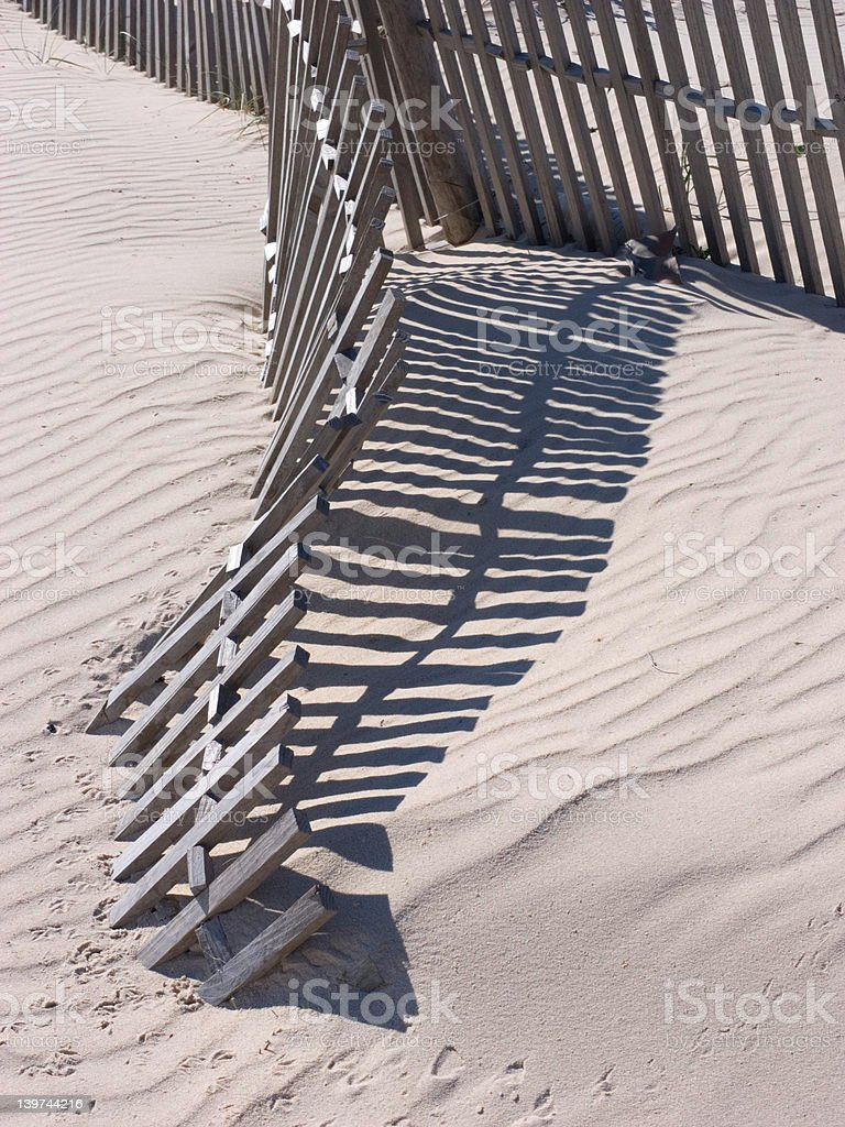 Wooden fence on a beach royalty-free stock photo
