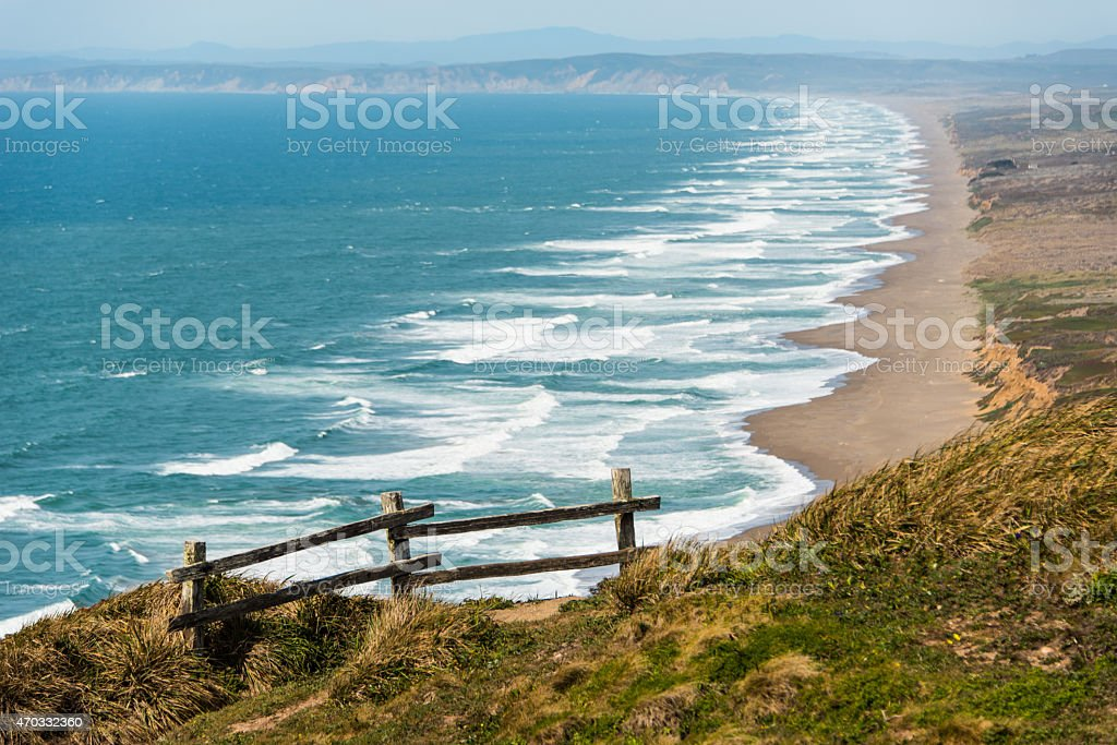 Wooden fence on a cliff by the Pacific Ocean stock photo