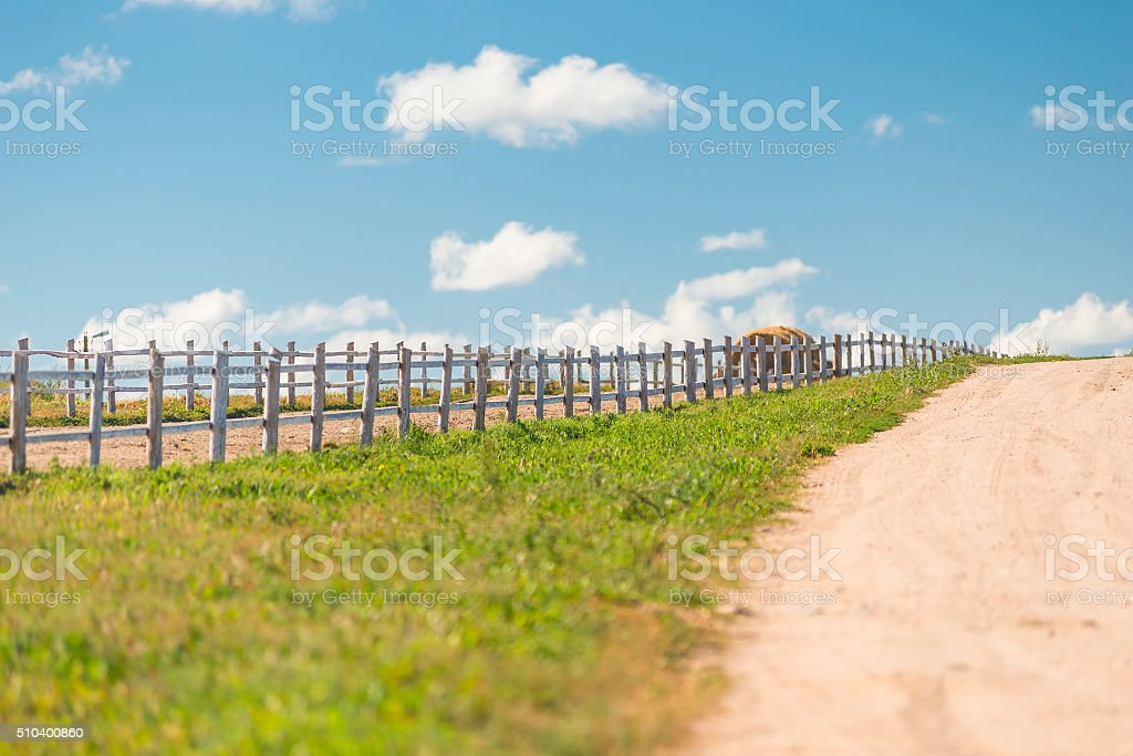 wooden fence on a ranch in a beautiful location stock photo