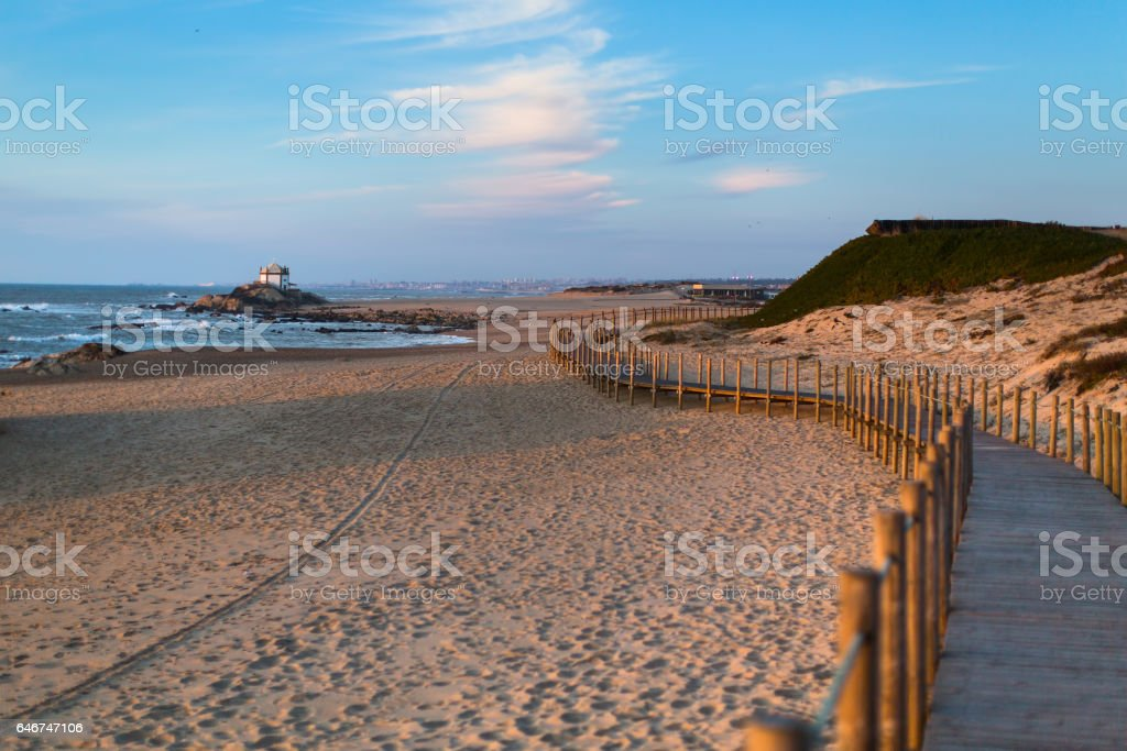 Wooden fence on sand dunes at Miramar beach on the Atlantic coast of Portugal. stock photo
