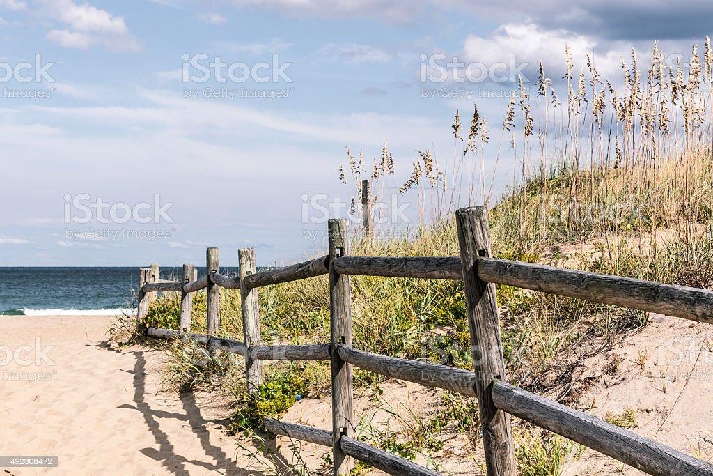 Wooden Fence on Sandy Pathway at Sandbridge stock photo