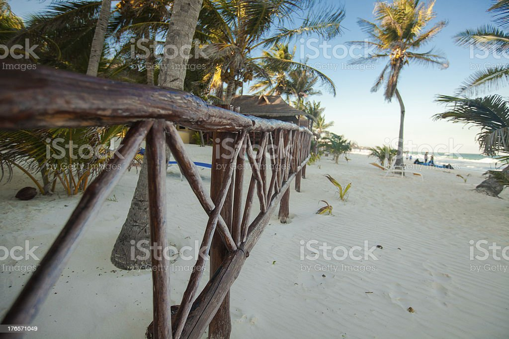 Wooden fence on tropical white beach royalty-free stock photo