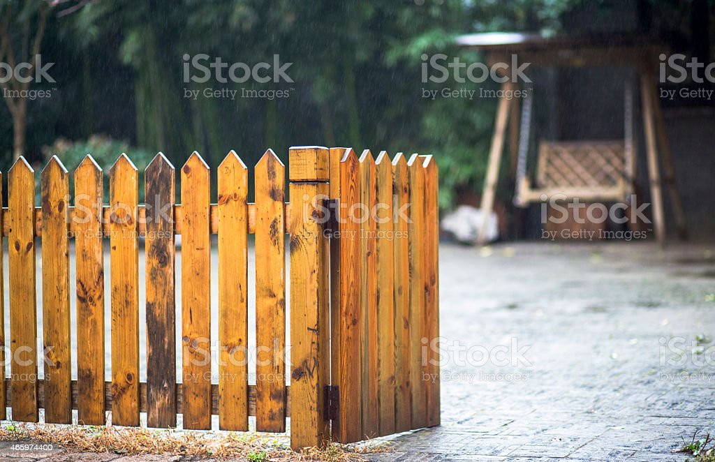 wooden fence outside a yard stock photo