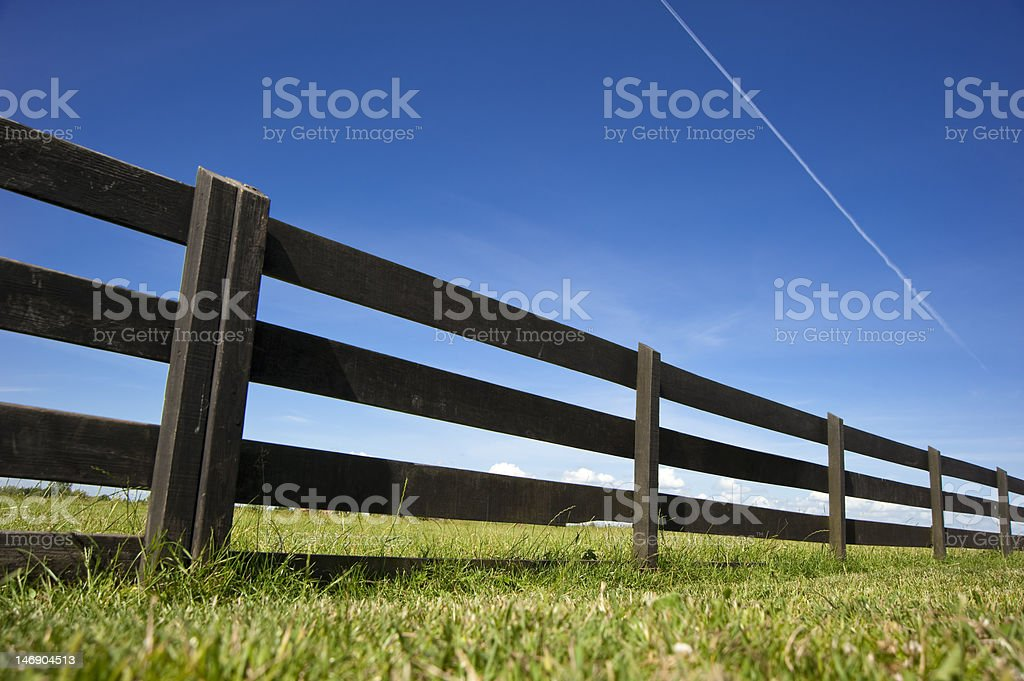 Wooden Fence Under Blue Sky royalty-free stock photo