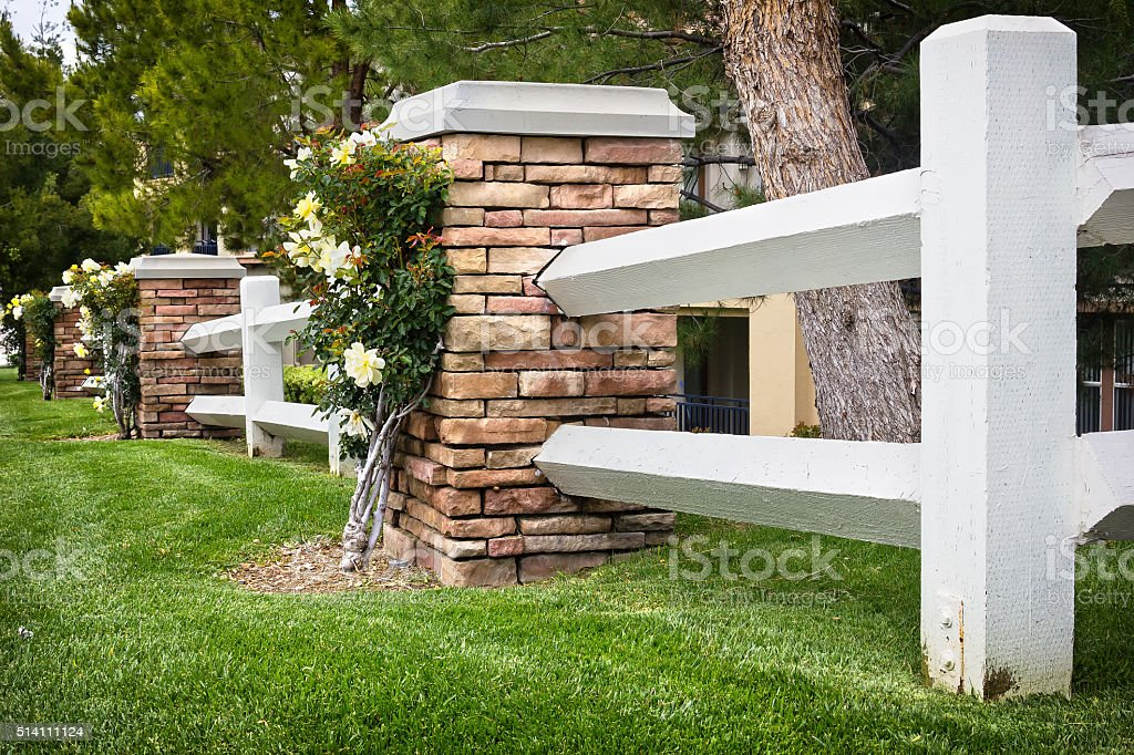 Wooden Fence use with Stone stock photo
