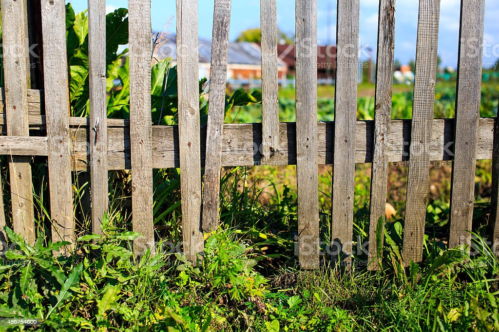wooden fence with a loophole stock photo