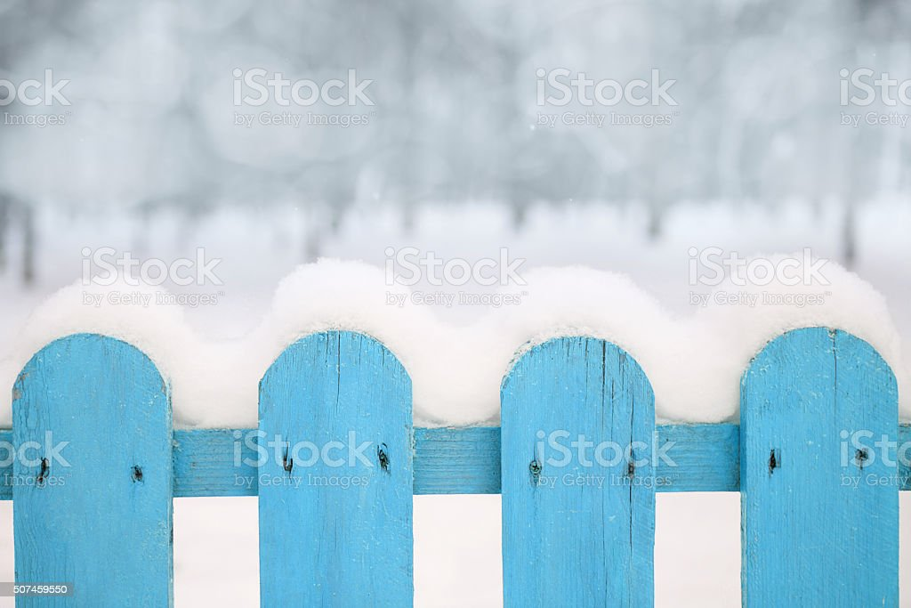 Wooden fence with snow. stock photo