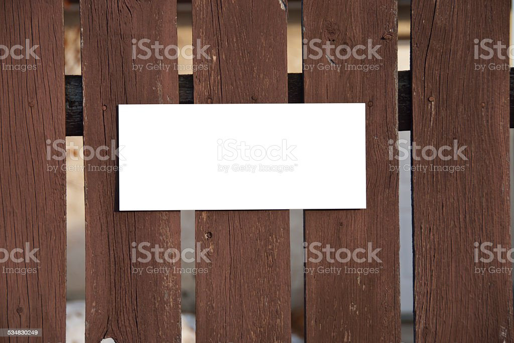 Wooden Fence with White Knock Out Sign. stock photo