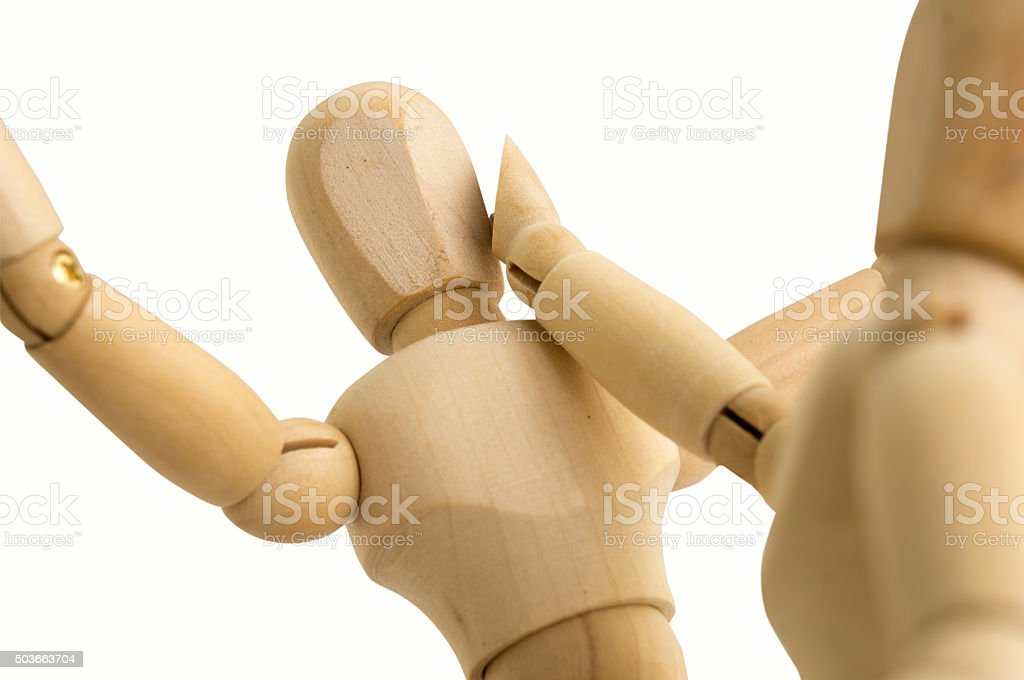 wooden figure abuse hitting concept stock photo
