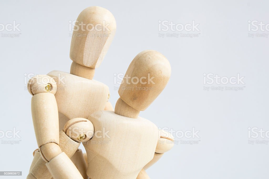 wooden figure hug man and woman concept stock photo