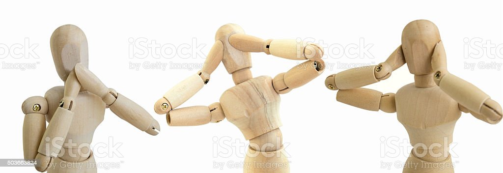 wooden figure no see speak hear doll concept stock photo