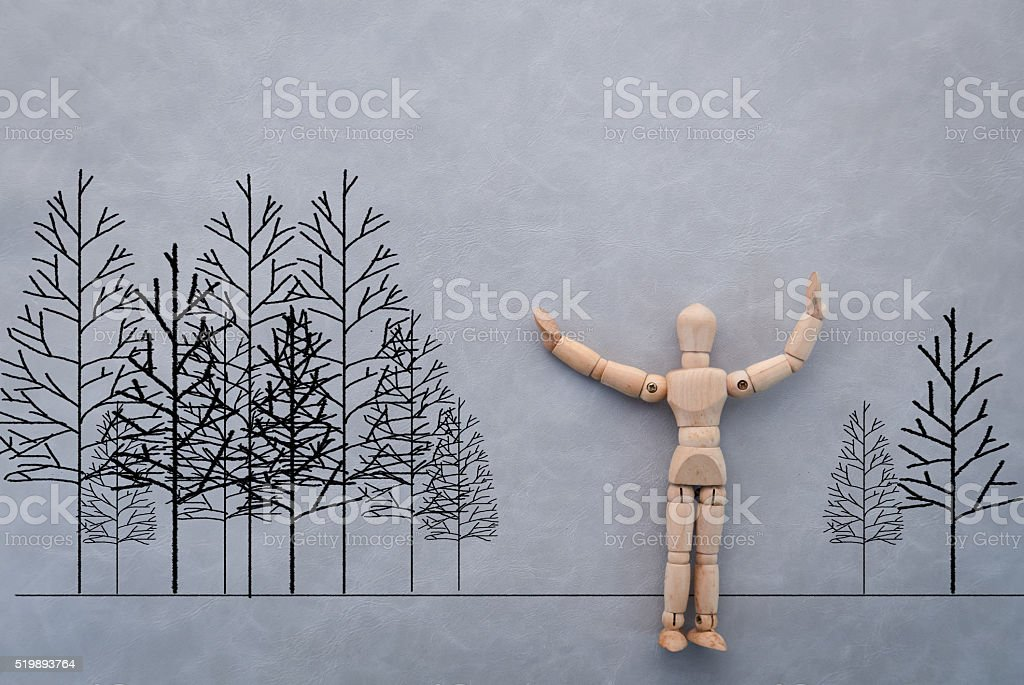wooden figure on grey background with drawing.jpg stock photo