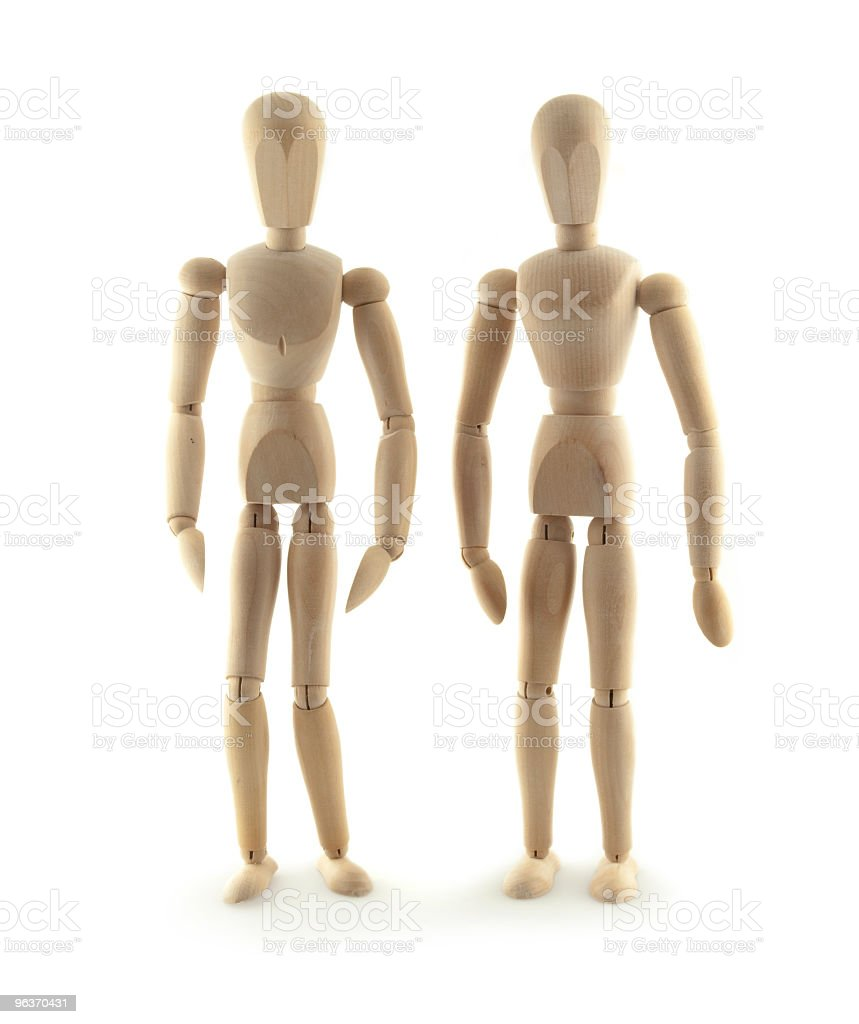 Wooden Figurines Standing Side-by-side royalty-free stock photo