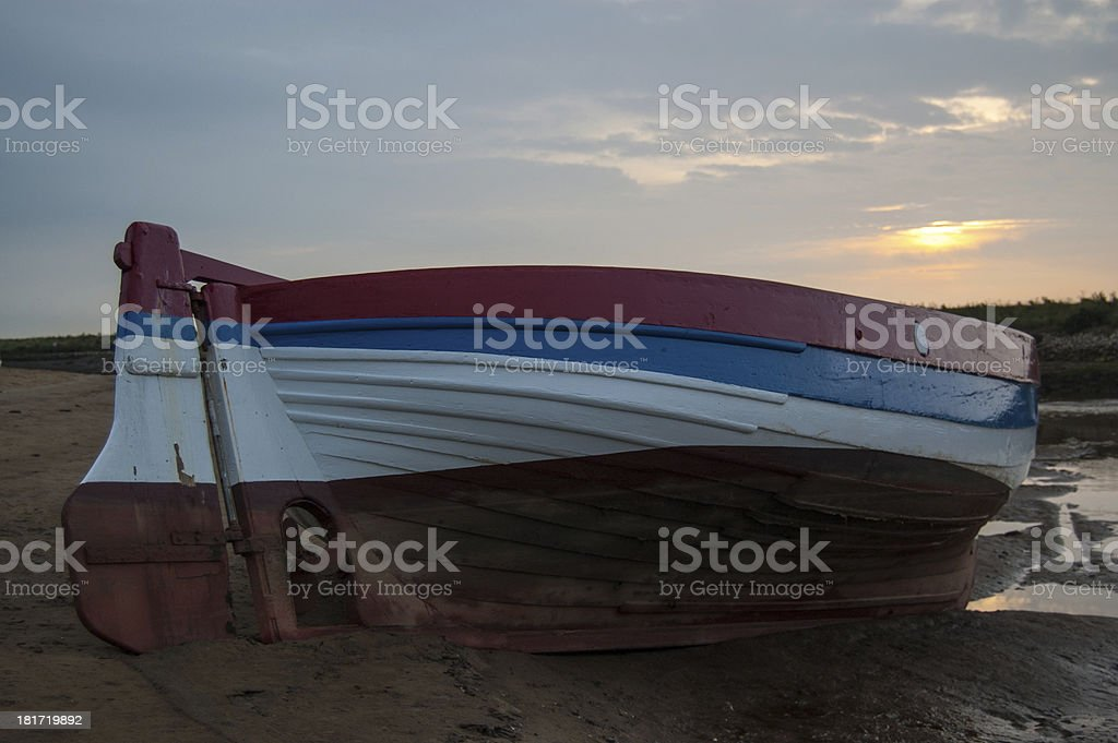 Wooden Fishing Boat at Low Tide stock photo