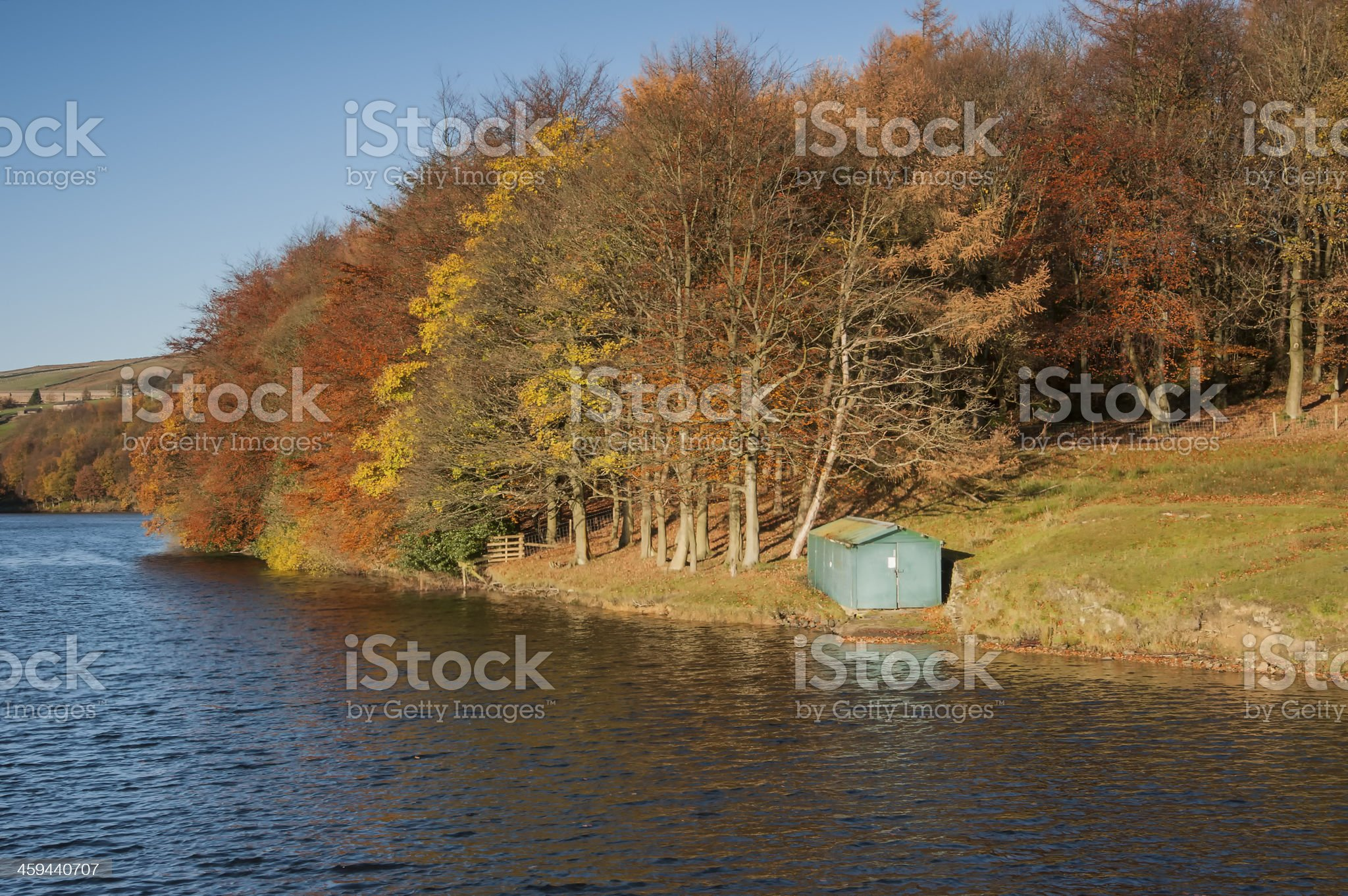 wooden fishing boat hut in autumn landscape royalty-free stock photo